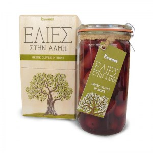 greek olives and capers in brune put in glass jar and handmade wooden gift box